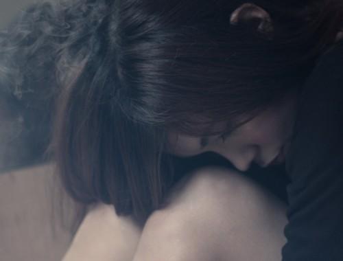 crouching woman